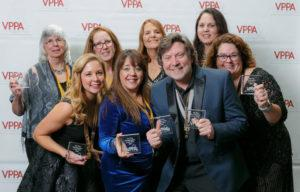 Erin Bonilla among other photographers at a VPPA event
